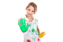 Happy girl with hands in paint Royalty Free Stock Image