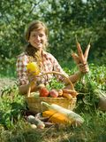 Happy girl with harvest Royalty Free Stock Photography