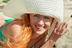 Happy girl in hat on beach. Royalty Free Stock Image