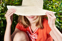 Happy girl with hat in summer garden Royalty Free Stock Photo