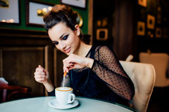Happy girl have cup of coffee indoors Royalty Free Stock Image