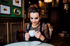 Happy girl have cup of coffee indoors Stock Photos