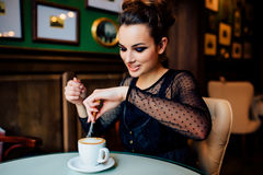 Happy girl have cup of coffee indoors Stock Photography