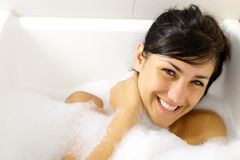 Happy girl having fun in bathtub smiling Stock Photos