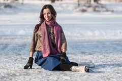 Happy girl having fun on ice skates. Stock Image