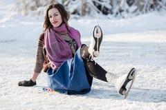 Happy girl having fun on ice skates. Royalty Free Stock Images