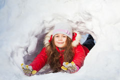 Happy girl having fun in snow tunnel Royalty Free Stock Image