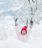Happy girl having fun on snowing winter day. Stock Photography