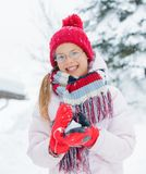 Happy girl having fun on snowing winter day. Stock Photo