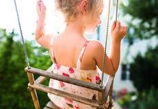 Happy girl having fun on a swing Stock Photos