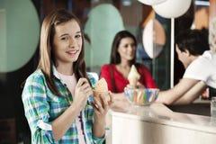 Happy Girl Having Ice Cream At Parlor Stock Photos