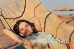 Happy girl is having a rest in hammork Stock Image