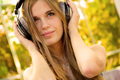 Happy girl with headphones. Freedom concept photo, woman with headphones Stock Photography