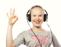 Happy girl with headphones Stock Photos