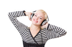 A happy girl in headphones listening music Stock Photography