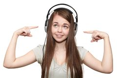 Happy girl listening to the music. Happy girl with headphones listening to music Royalty Free Stock Photography