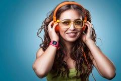 Happy girl in headphones listening to music. Stock Image