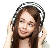 Happy girl listening to the music. Happy girl with headphones listening to music Stock Images