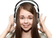 Happy girl listening to the music. Happy girl with headphones listening to music Royalty Free Stock Image