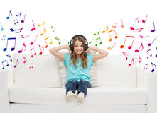 Happy girl in headphones listening to music Stock Images