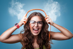Happy girl in headphones listening to music. Royalty Free Stock Images