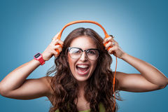 Happy girl in headphones listening to music. Stock Photography