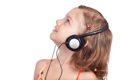 Happy girl with headphones looking up Royalty Free Stock Photography