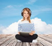 Happy girl with headphones and tablet pc Royalty Free Stock Photos