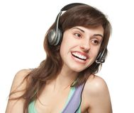 Happy girl with headset Royalty Free Stock Image