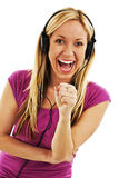 Happy girl in headset singing Royalty Free Stock Image