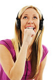 Happy girl in headset singing Stock Photos