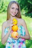 Happy girl and healthy vegetarian food, fruit Stock Image