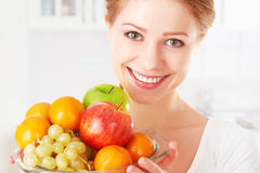 Happy girl and healthy vegetarian food, fruit Stock Photo