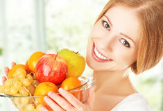 Happy girl and healthy vegetarian food, fruit Royalty Free Stock Photos