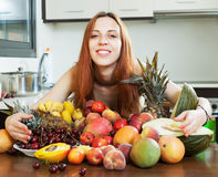 Happy girl with heap of fruits Royalty Free Stock Photos
