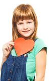 Happy girl with heart shape. Happy Caucasian girl holding heart shape, smiling and looking at camera Stock Photo