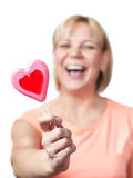 Happy girl with heart shaped lollipop Royalty Free Stock Photo