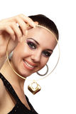 Happy girl with heart shaped necklace Stock Image