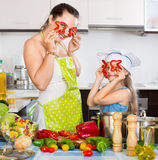 Happy girl helping her mother to cook Royalty Free Stock Photography