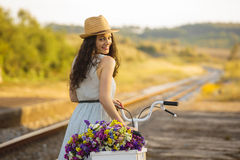 Happy girl with her bicycle Royalty Free Stock Image