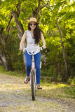 Happy girl with her bicycle Royalty Free Stock Photo