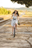 Happy girl with her bicycle Stock Photography
