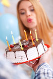 Happy girl and her birthday cake Royalty Free Stock Images