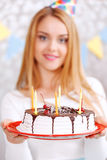 Happy girl and her birthday cake Royalty Free Stock Photos