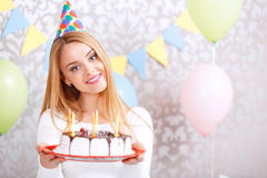 Happy girl and her birthday cake Stock Photo