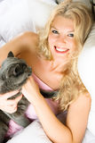 Happy girl with her cat Stock Images