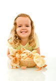Happy girl with her Easter baby chickens Stock Photography