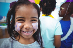 Happy girl with her face painted Royalty Free Stock Photography
