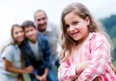 Happy girl with her family Stock Image