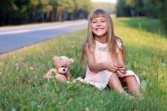 Happy girl with her friend Teddy bear Stock Photo